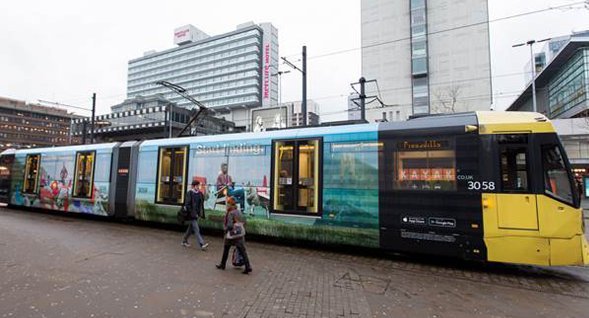 """New tram wraps announce """"Stop searching. Start finding on KAYAK.co.uk"""""""