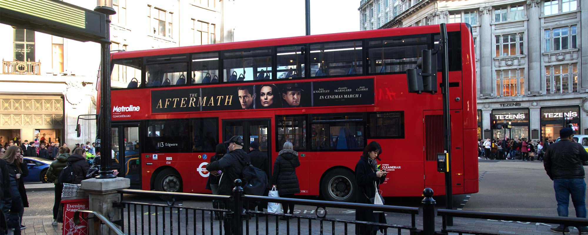 The Aftermath advertising on the side of a bus