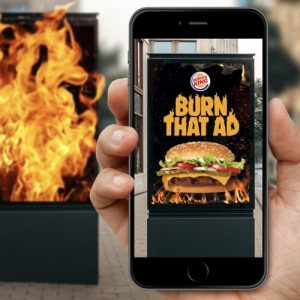 Burger King augmented reality app 'burning' a rival billboard ad